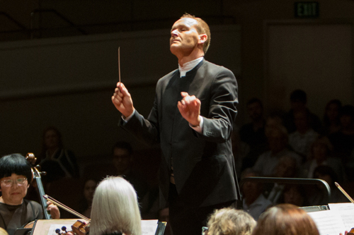 Photo of a conductor of SLO Symphony