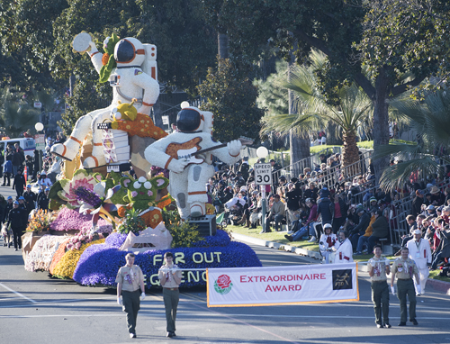 Far Out Frequencies float with scouts carrying award banner