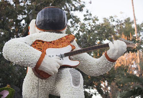 12-foot astronaut holds guitar