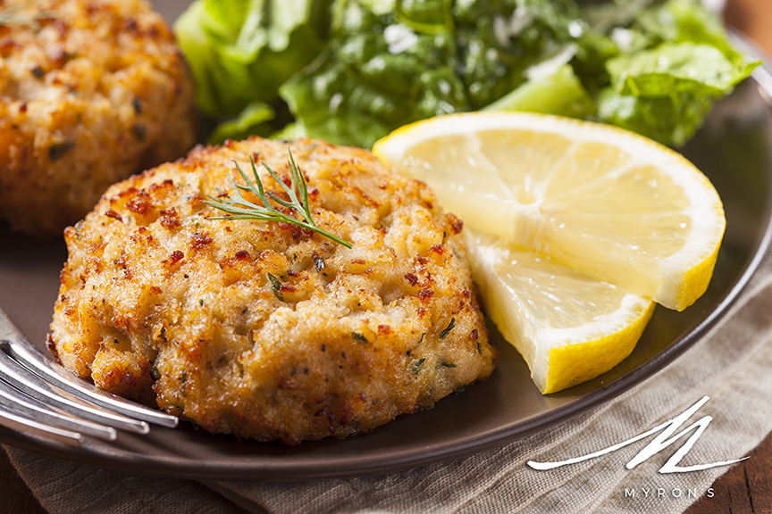 Photo of crabcakes with Myrons logo