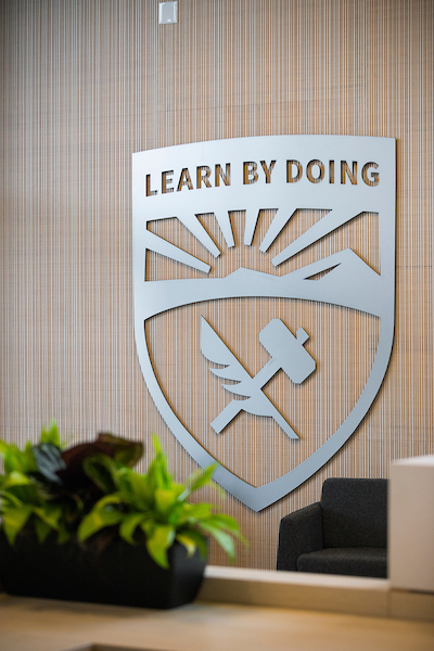 The Cal Poly Learn by Doing logo at the Cal Poly Welcome Center. Photo by University Photographer Joe Johnston.