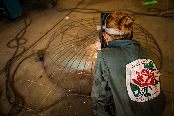 """Students at work on the 2020 Cal Poly Rose Float, """"Aquatic Aspirations."""" Photo by Joe Johnston, Cal Poly"""