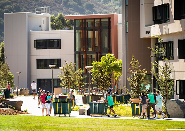Photo of students moving into the new yakʔitʸutʸu residential community on campus.