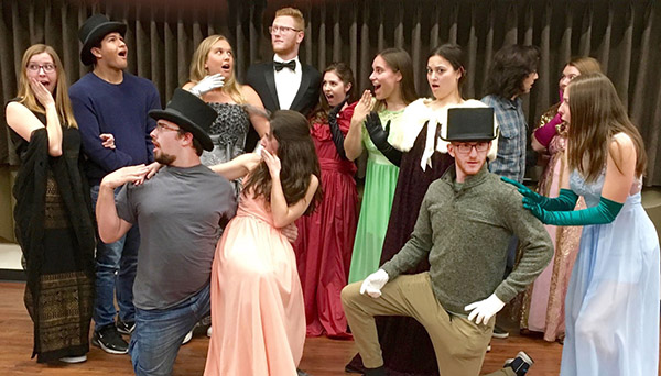 Photo of a dozen students in Student Opera Theatre posing for a photo to promote their cabaret-style showcase