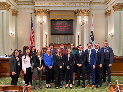 Cal Poly President Jeffrey D. Armstrong, his wife, Sharon Armstrong, accompany Cal Poly student who were recognized on the floor of the California state Senate and Assembly on March 2.