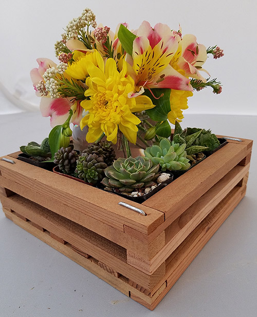 Photo of a floral arrangement with fresh flowers and succulents.