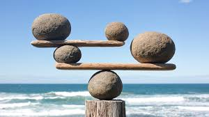 Photo of stones balanced on a beach.
