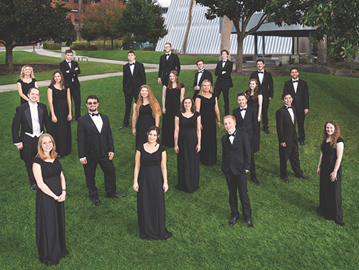 Photo of members of Cal Poly Chamber Choir standing outside Philips Hall at Cal Poly.