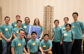 Cal Poly Seismic Design Team at the competition with balsawood tower and poster.