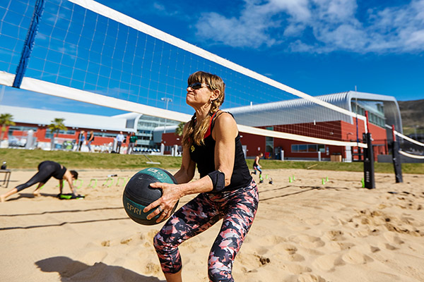 Photo of a woman playing volleyball at the Cal Poly Recreation Center.