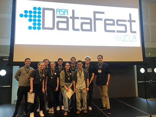Cal Poly students pose for a photo at a DataFest event