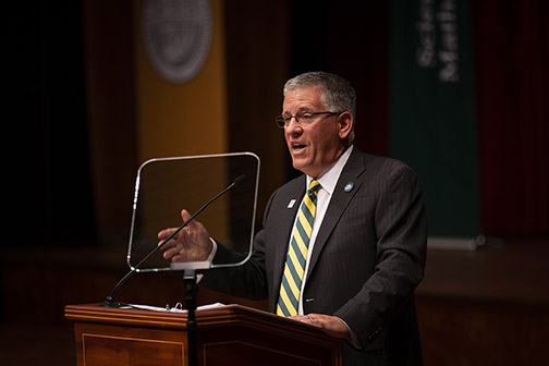 President Armstrong speaking at Fall Convocation.