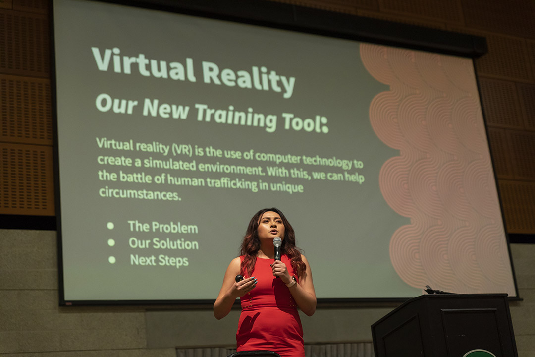Cal Poly student Zahnae Aquino speaks about her project during the CCI's Human Trafficking Summit on campus.
