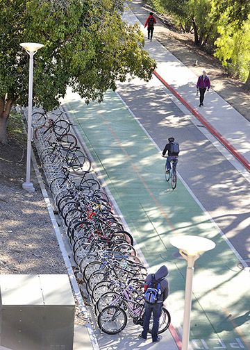 Students park their bikes and ride along Via Carta, near the Baker Center for Science and Mathematics (No. 180), in the core of Cal Poly's campus. Some new bike racks were recently installed along this stretch of Via Carta.