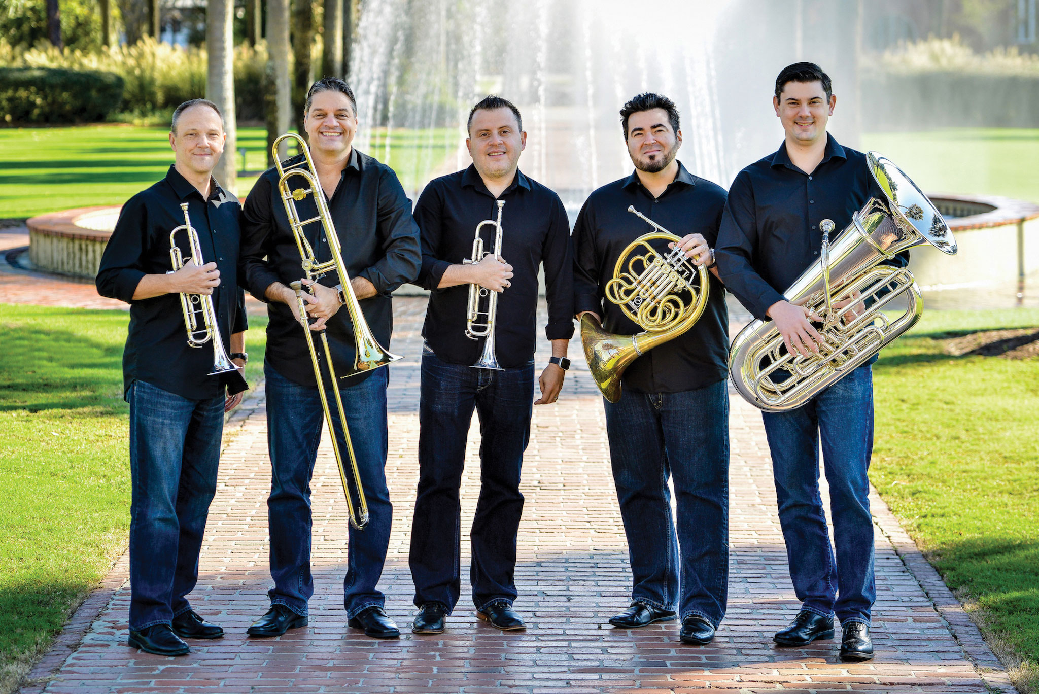 Members of Boston Brass pose for a photo.
