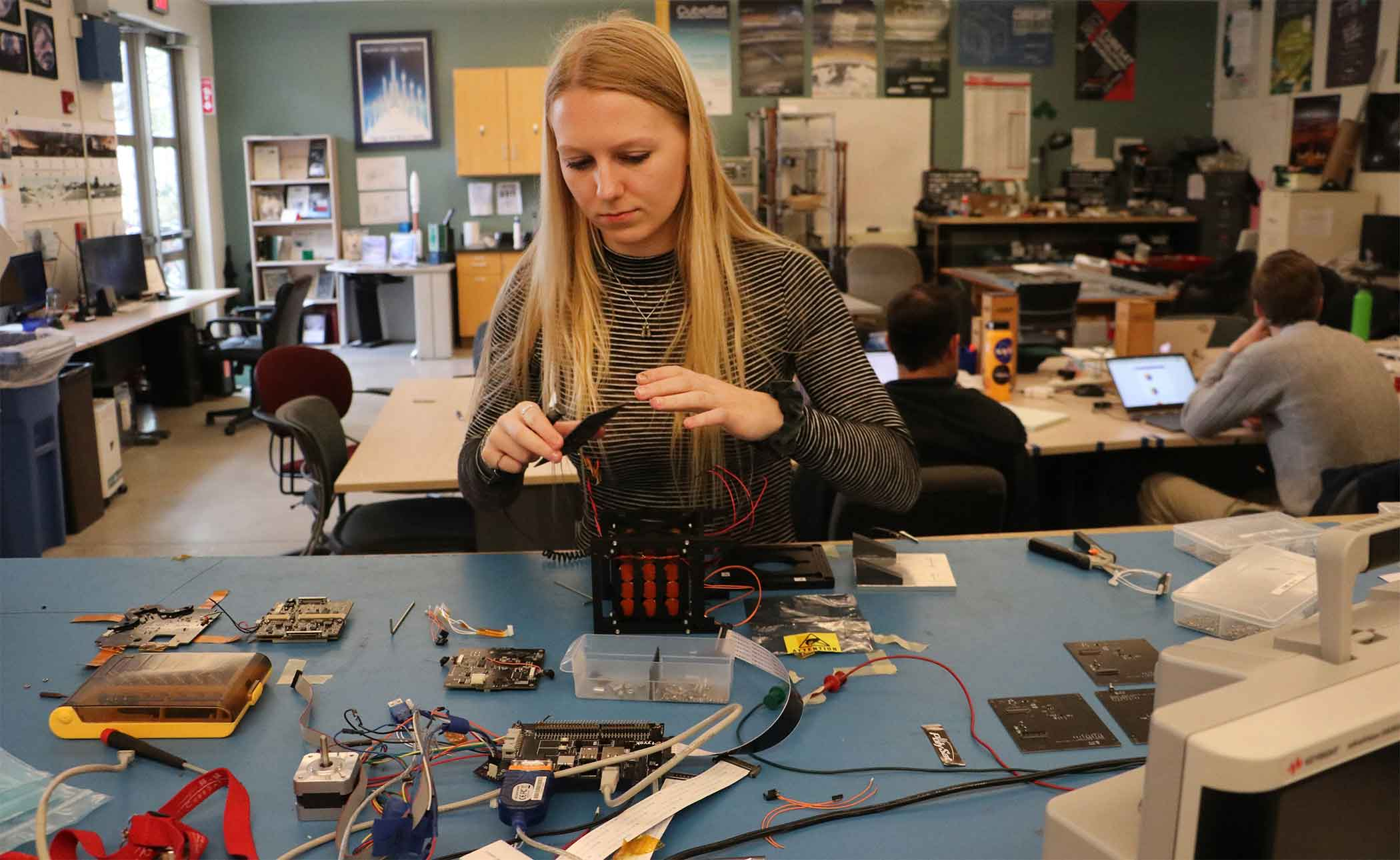 Brigitte Petersen, an aerospace engineering student, is the project manager for two Cal Poly CubeSat missions that will test drag sails as a means to safely deorbit miniature satellites. A partnership with the Air Force Research Laboratory will help Cal Poly explore propulsion techniques for CubeSats.