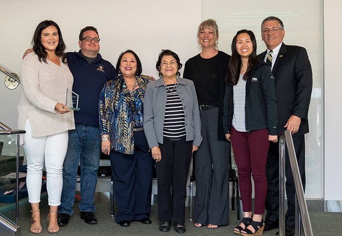 Members of the Cross Cultural Centers accept the Campus Organization award.