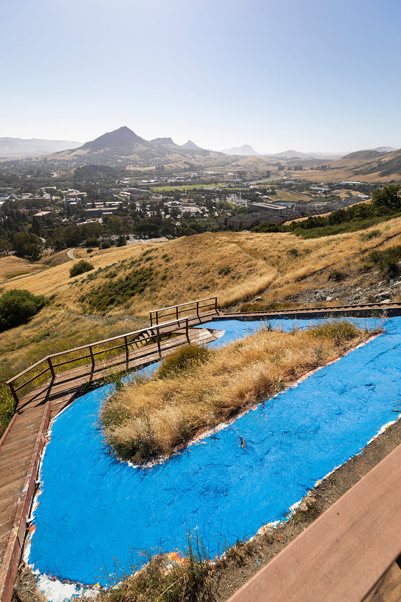 The Cal Poly P is painted blue as part of an effort to thank health care and other essential workers.