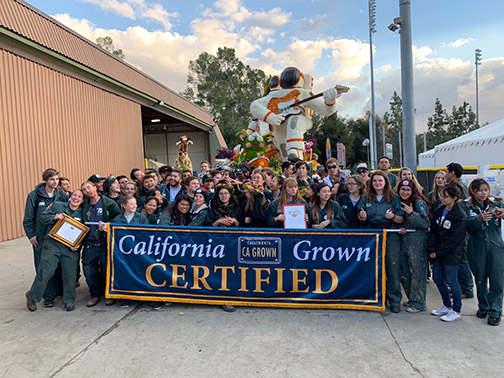 Students pose with a California Grown Certified banner prior to the Rose Parade.