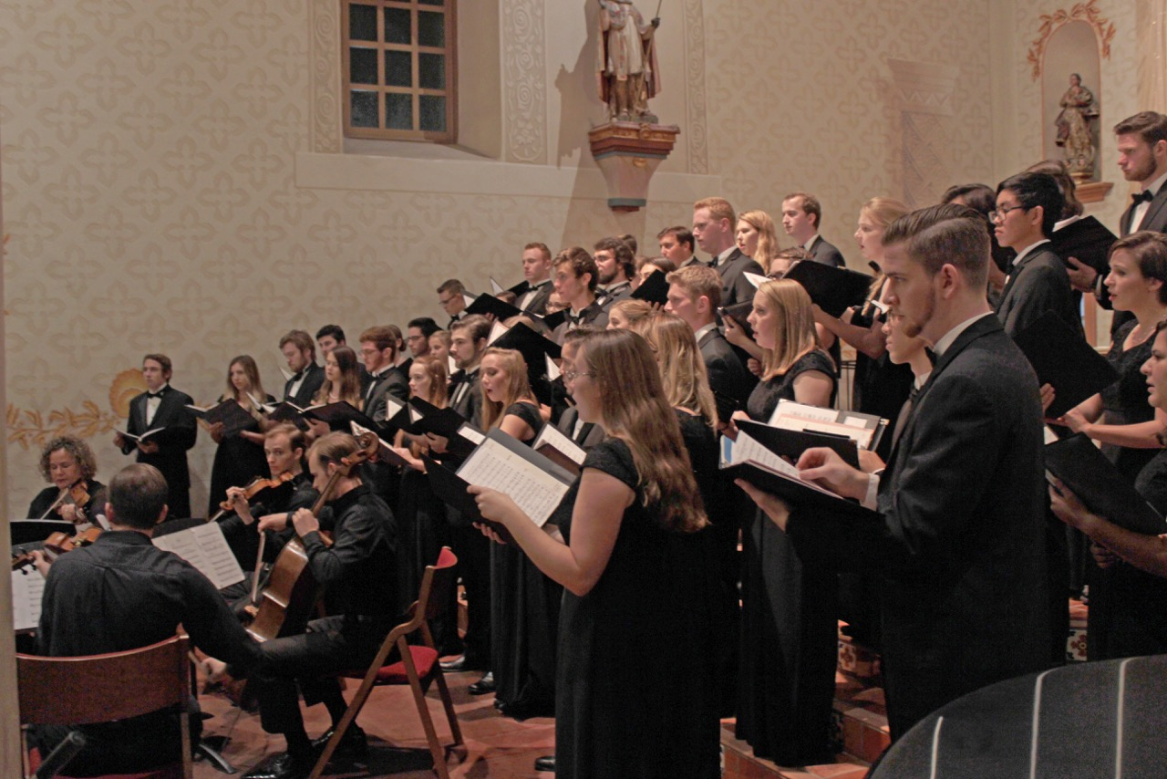 A photo of the choral ensembles during a performance last year.