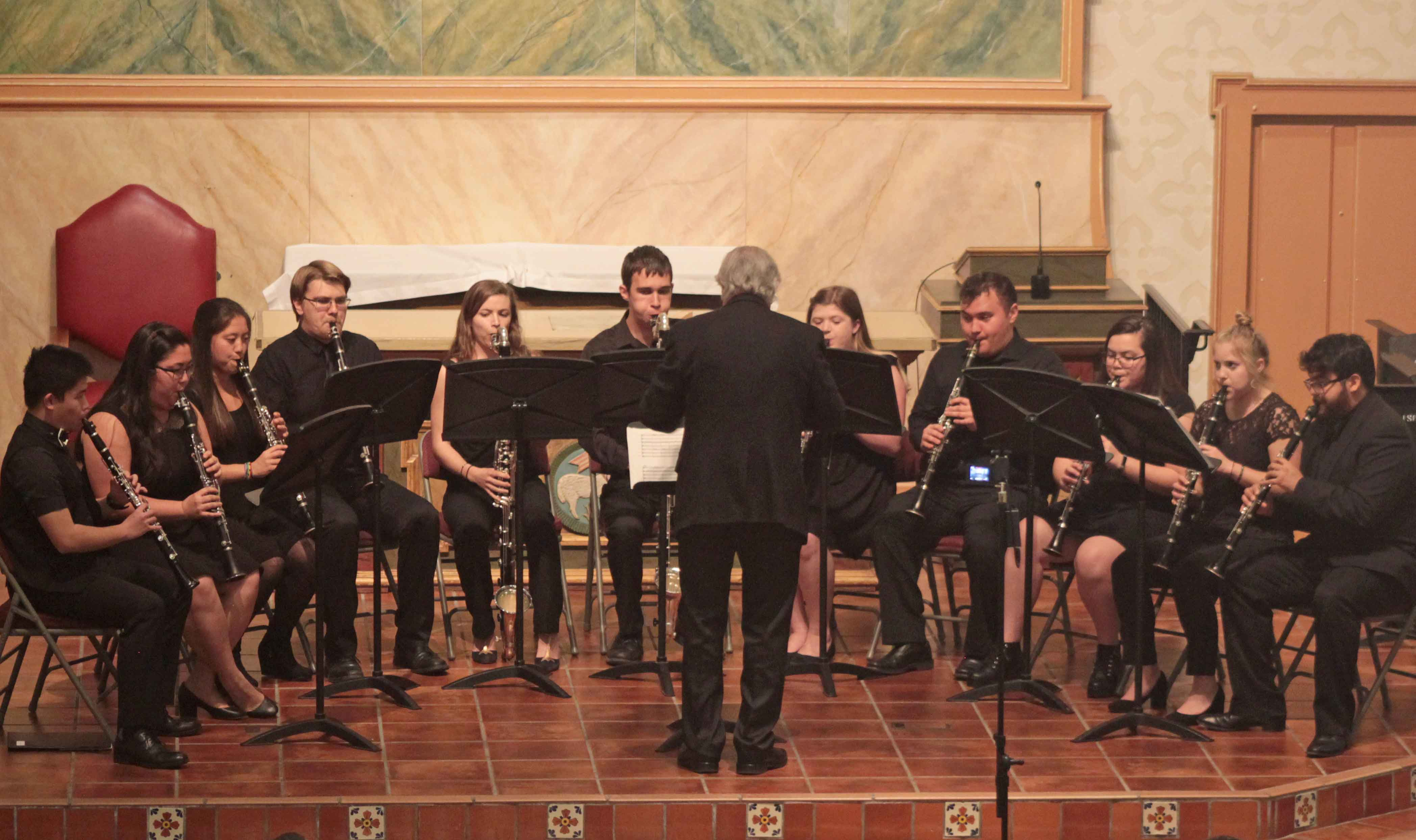 Keith Waibel conducts a Cal Poly clarinet ensemble during a concert in Mission San Luis Obispo. Waibel has organized the second annual Clarinet Festival which will take place at 6 p.m. Sunday, May 5, in Room 218 of the Davidson Music Center (No. 45) on campus.