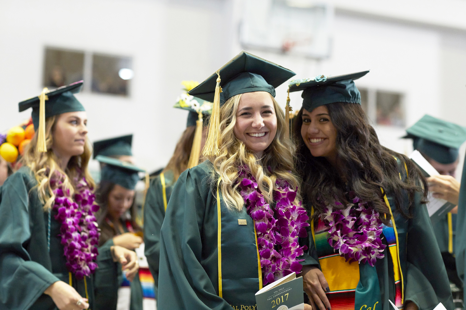 Photo of two students at a past commencement ceremony.