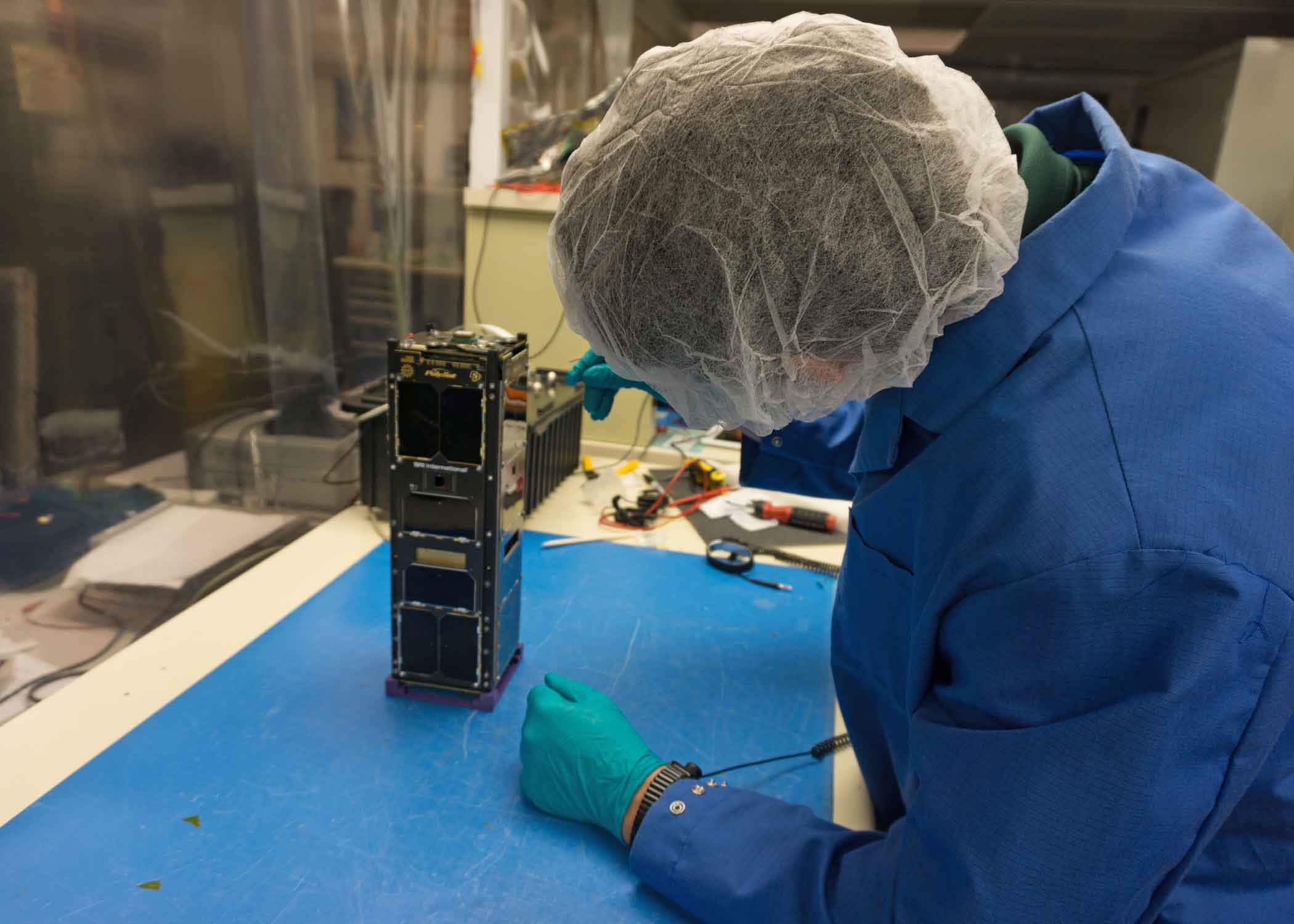 A student at the student-run PolySat research lab