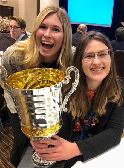 Cal Poly TAGA President Lauren Helms and Kayleigh Macdonald show their excitement on winning the annual student prize at this year's TAGA Conference.
