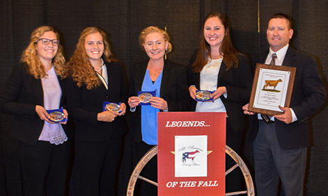 From left to right, Elise Regusci, Elisabeth Regusci, Hannah Neer, Alex Gambonini, and coach Rich Silacci at the All-American Dairy Show awards ceremony.