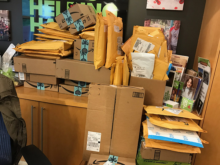 A photo of numerous packages purchased through Amazon and delivered directly to local nonprofit Jack's Helping Hand.
