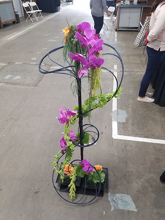 Photos of arrangements by the second-place winner, agricultural science junior Amber Buzzard.