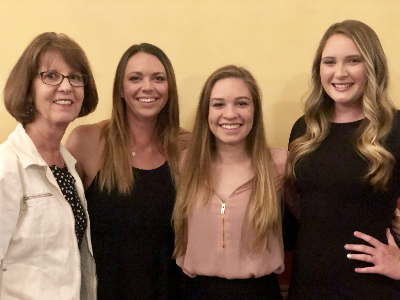Left to right, Melinda Lynch, Amber Buzzard, Megan Borzone, and Alyssa Snow at opening night of the 2019 American Institute of Floral Designers Symposium.