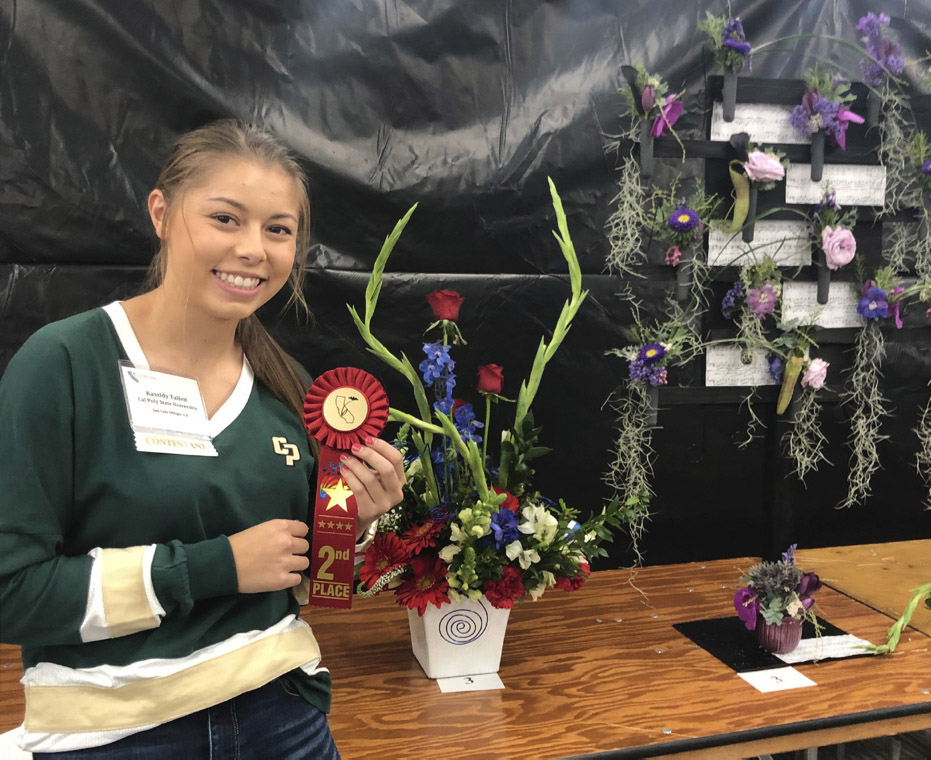 Cal Poly freshman Kassidy Talbot with her second-place winning entry at the California State Floral Association's 14th annual student competition.