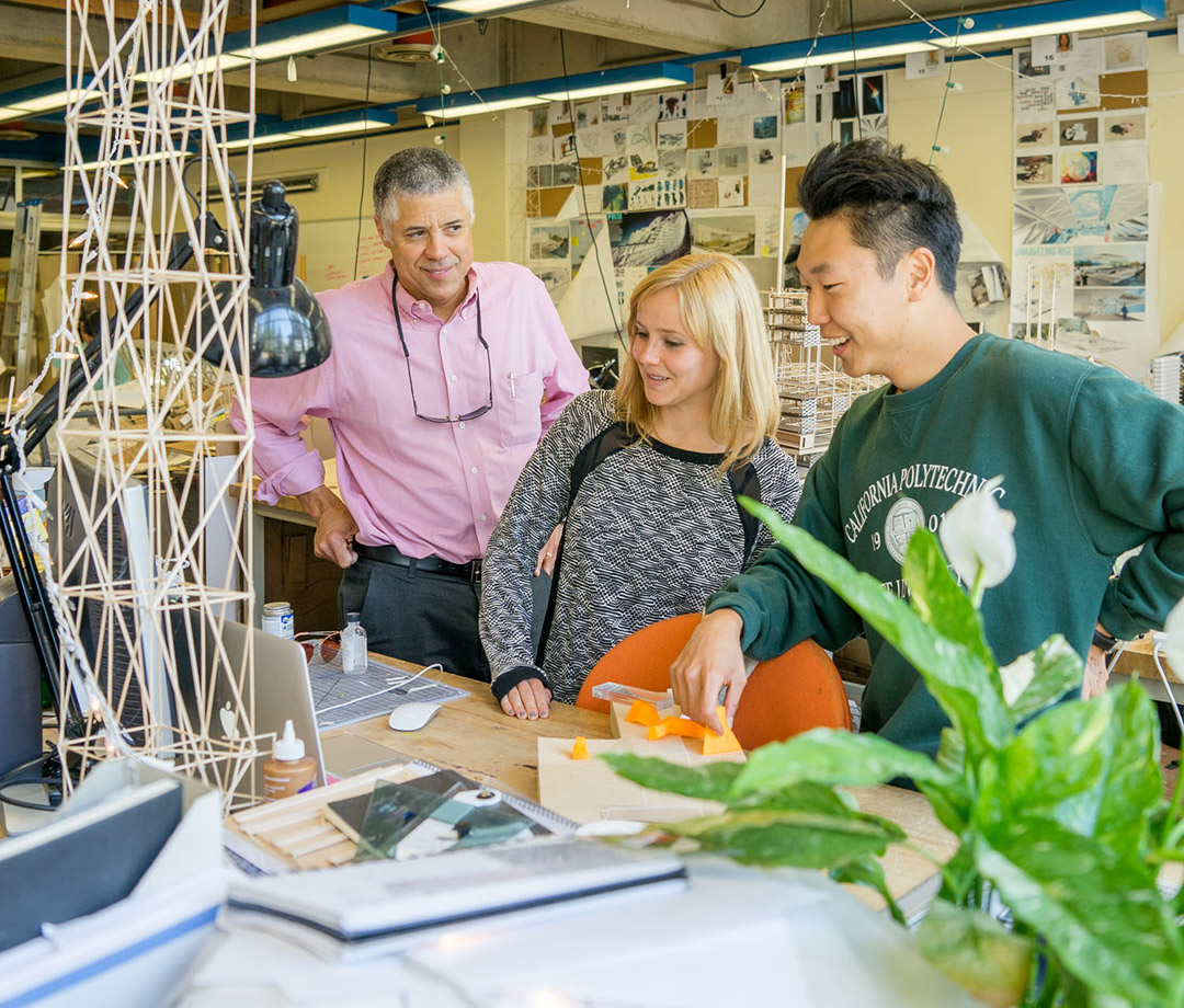 Cal Poly Architecture Professor Thomas Fowler and architecture students Emma Entress and John Kim Jr. review conceptual work in a third-year design studio.