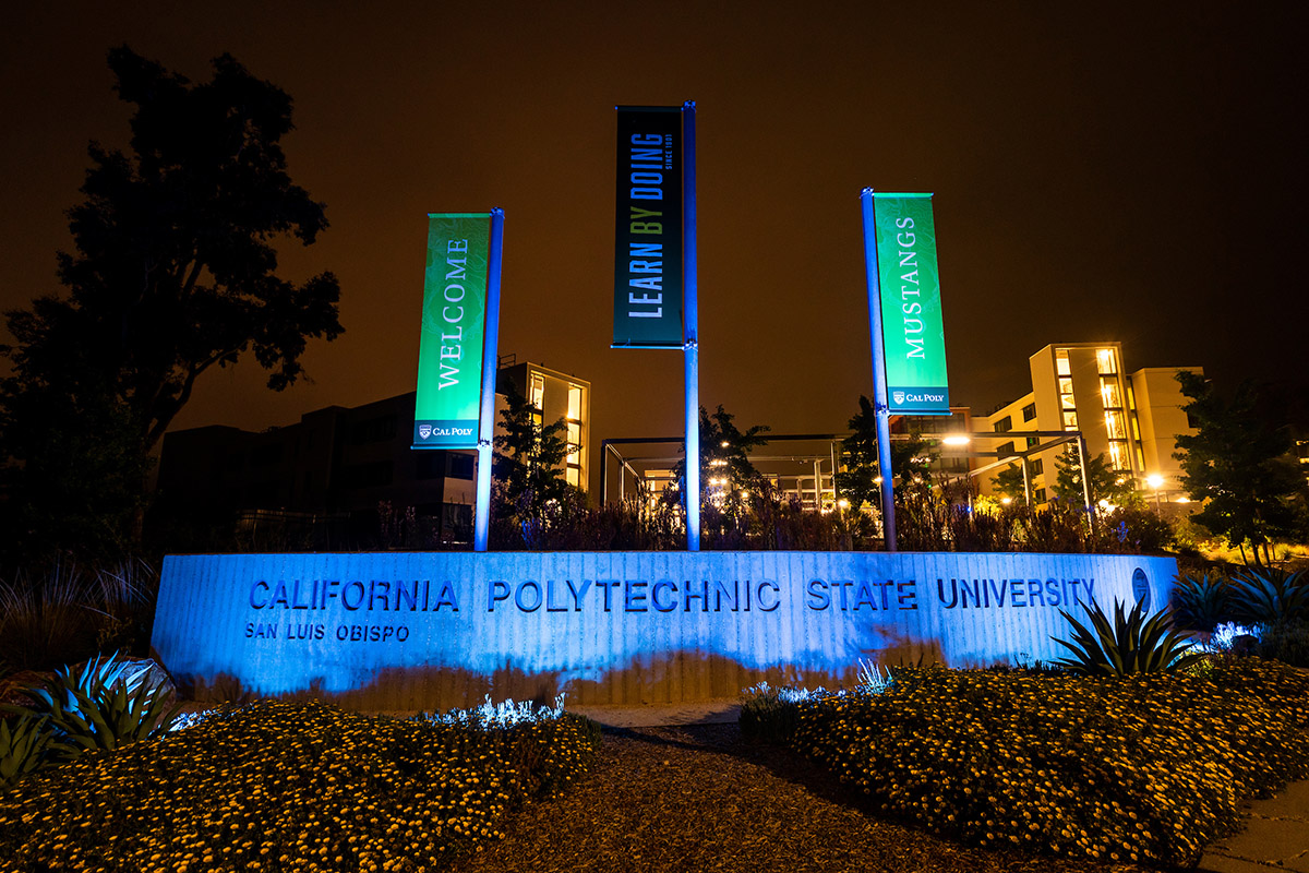 The Grand Avenue entrance to Cal Poly is illuminated with blue lights to thank health care and other essential workers.