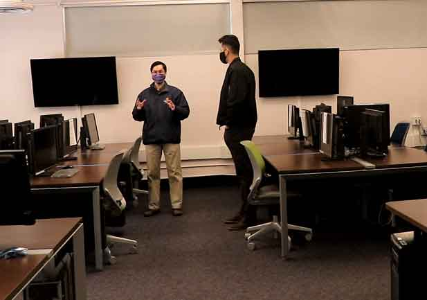 Professor John Seng tours the newly named Hewlett Packard Enterprise Massively Parallel Accelerated Computing Lab with former student Daniel Jones, now an HPE engineer.
