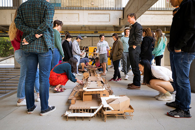 Cal Poly architecture and architectural engineering students connect their cardboard models of the Harford Pier. On Feb. 28, their drawings and models will be on display for the campus community and public to view.
