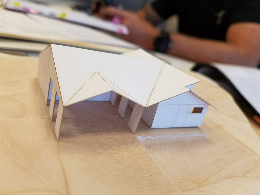 A model of a home designed for a 6,150-square-foot parcel in Weed, California.