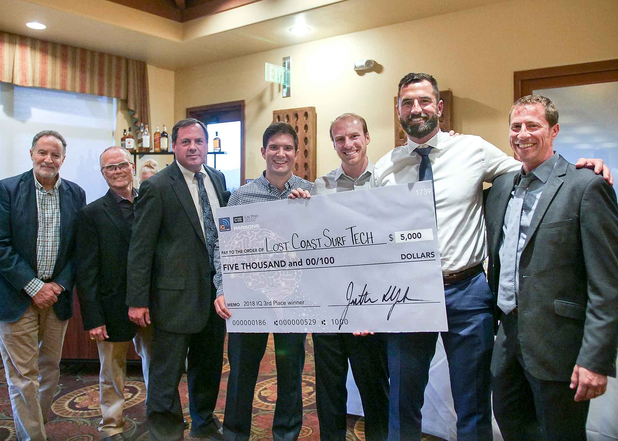 Members of Lost Coast Surf Tech, which designed what they call the world's best performing surfboard fin with smart tracking features integrated into a comprehensive mobile app, stand with judges after receiving the 2018 Innovation Quest's $5,000 third-place award on April 28 at the San Luis Obispo Country Club. The competition was sponsored by Cal Poly's Center for Innovation and Entrepreneurship.