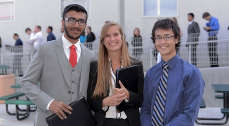 Three students seeking internships pose outside the Cal Poly Recreation Center.