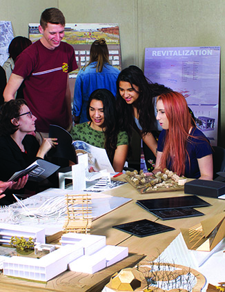 Cal Poly landscape architecture students examine design concepts and site models.