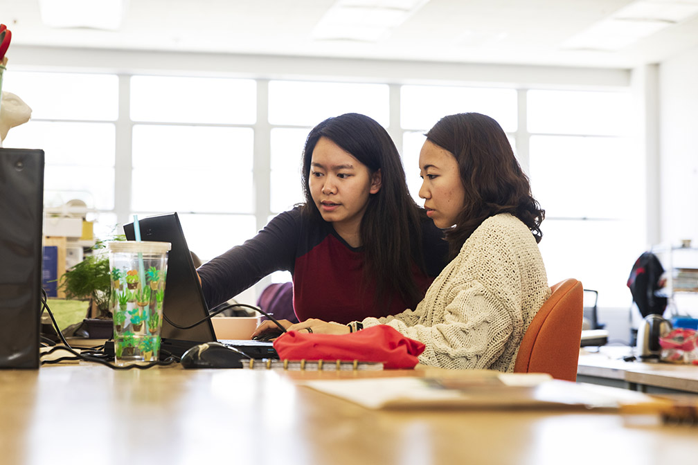 Architecture student Alyson Liang (right) of Santa Rosa, California, who is working on a recreation center for Paradise, pictured with student Kaye Lao.
