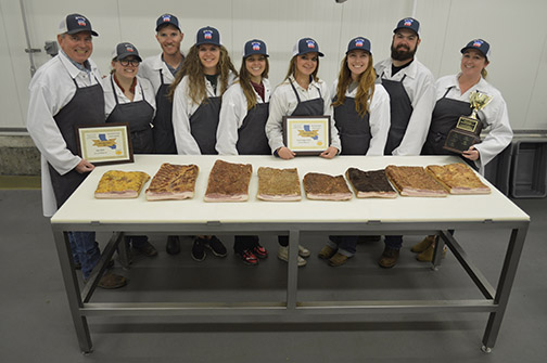 Jim Douglass, manager of the J and G Lau Family Meat Processing Center, and students Catie Field, Lane Koontz, Beaujena DeSilva, Toni DeMatteo, Veronica Staggs, Kira Olson, Connor Smith and Morgan Metheny.