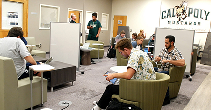 Student athletes studying in a Mustang lounge.