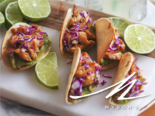 Photo of tacos and limes