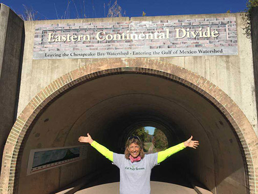 Nanine VanDraanen posing in front of the Eastern Continental Divide