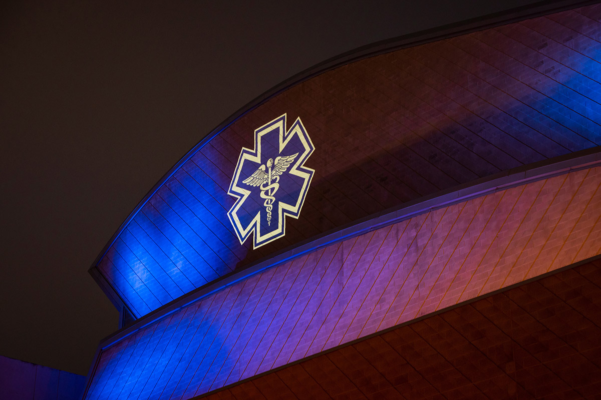 The Performing Arts Center is illuminated with blue lights to thank health care and other essential workers.