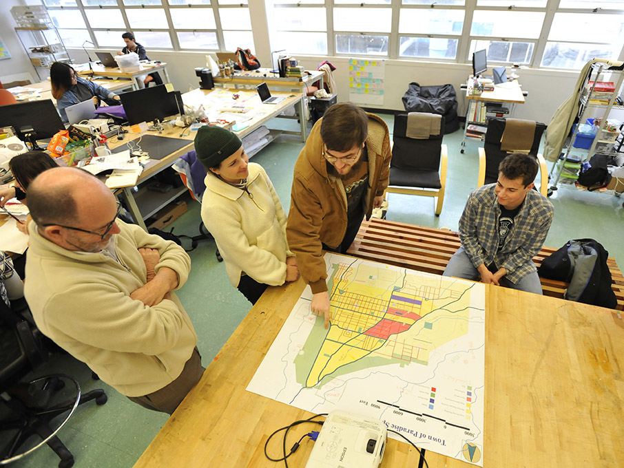 From left to right, Cal Poly architecture faculty member Kent Macdonald, and students Sophia Smith, Ryan Huddlestun and Foster Westover describe their proposed concept plan for the town of Paradise.