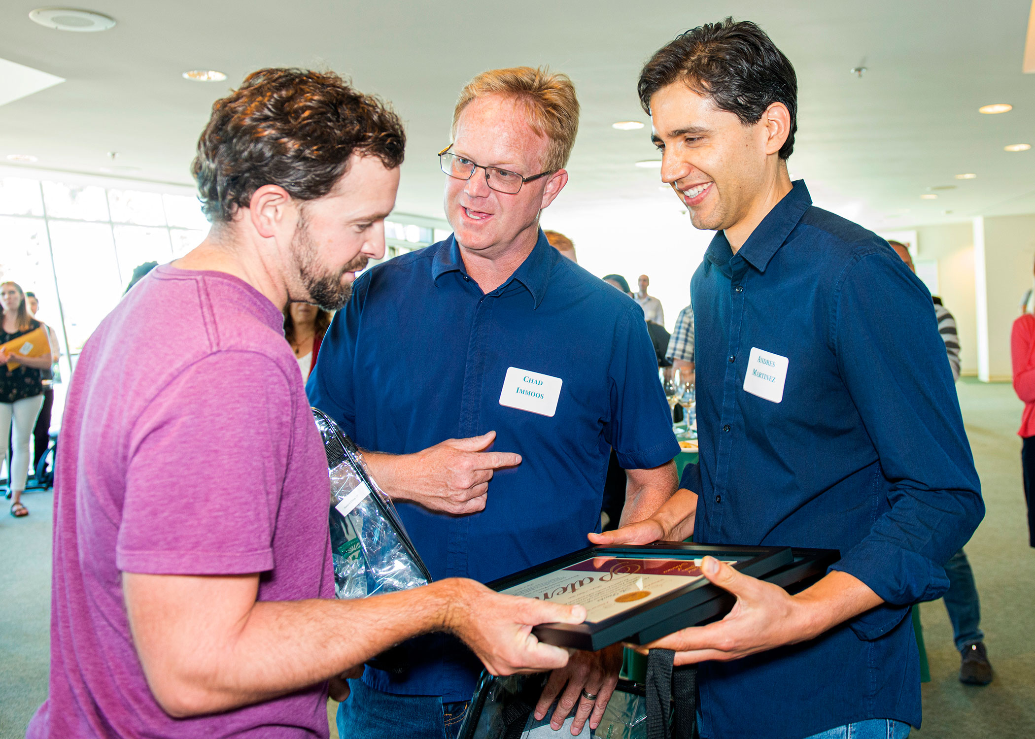 Cal Poly faculty members (from left) Phil Costanza, Chad Immoos and Andres Martinez, all from the College of Science and Mathematics, celebrate after being honored by the university for receiving two patents for medical test devices.