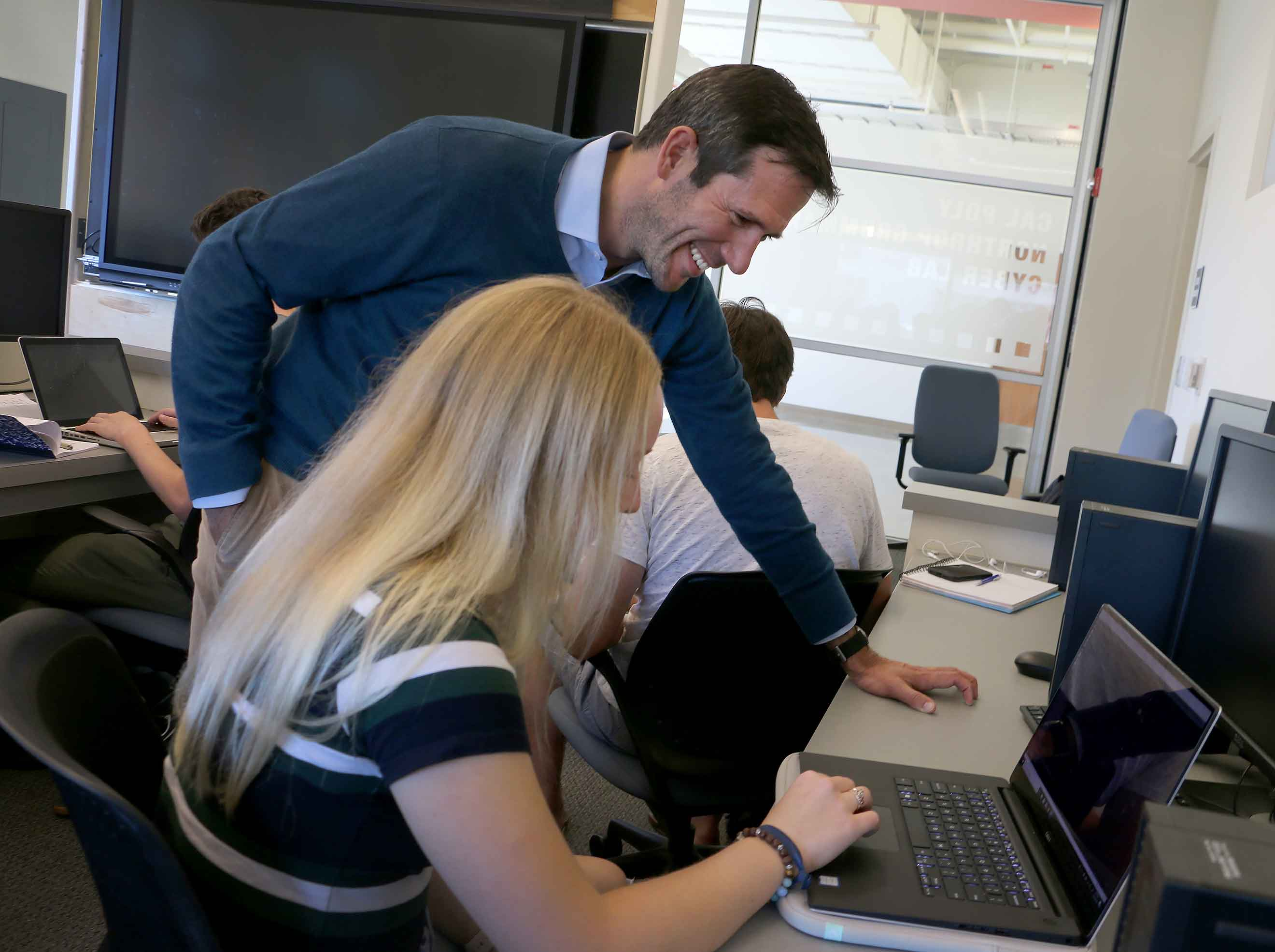 Associate Professor Zachary Peterson speaks to software engineering student Larissa Linden during a recent lab.